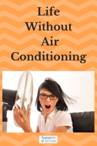 Life Without Air Conditioning grumpy woman with fan blowing on her hampersandhiccups