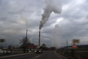 Indoor air quality affected by outdoor pollution in the air street factory smoke view