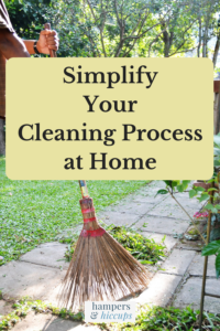 Simplify your cleaning process at home man sweeping the walkway in the backyard hampersandhiccups