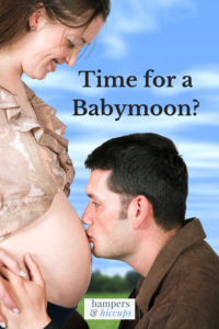 Time for a babymoon? man kissing pregnant wife's baby bump hampersandhiccups