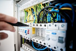 Home Maintenance Jobs best left to the professionals electrician tests the wiring