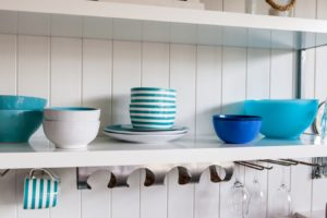 Family-friendly kitchen bright colored dishes on shelf