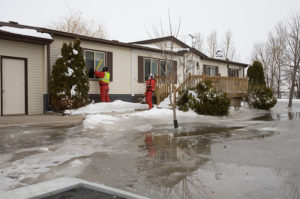 Winter home checks FEMA inspecting a home with ice flood damage in Minnesota