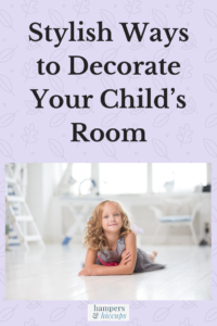 Stylish Ways to Decorate Your Child's Room a girl on the floor of her bedroom smiling hampersandhiccups