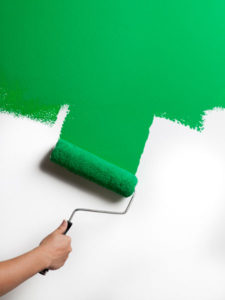 Home improvements more affordable painting a wall green with a paint roller hampersandhiccups