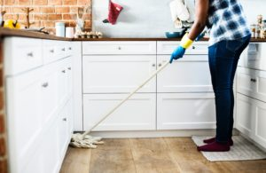 Speed up your household chores - woman mopping kitchen floor