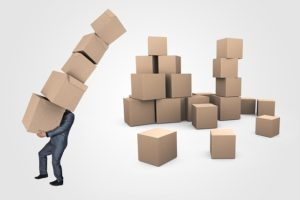 Painless homebuying experience man carrying many moving boxes