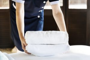 Cleaning the home easier woman with folded sheets