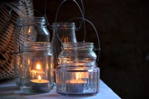 Rustic garden glass jars with lit candles