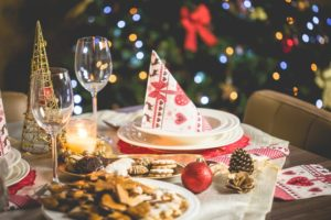 Festive Traditions holiday baking cookies and treats to eat with water glasses and decorative napkins