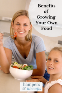 Benefits of Growing Your Own Food mother and daughter sharing a salad grown from their garden hampersandhiccups