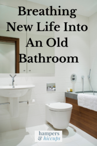 Breathing new life into an old bathroom a remodeled bathroom with a modern toilet sink tub hampersandhiccups