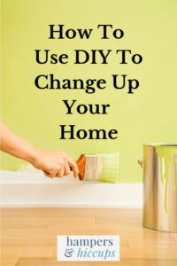 How To Use DIY To Change Up Your Home painting the wall with a paintbrush hampersandhiccups