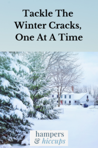 Tackle The Winter Cracks, One At A Time house surrounded by winter snow pine trees covered in snow hampersandhiccups