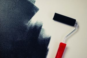 house makeover paint roller black paint on drywall