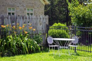Summer Backyard tiger lily chairs table grass fence