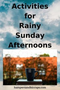 Activities for Rainy Sunday Afternoons cup of tea on stack of books in front of window raining hampersandhiccups