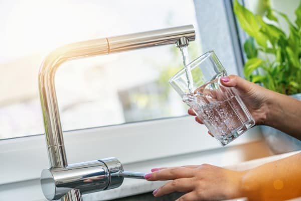Drinking filtered water from kitchen tap