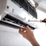 electrician-installing-air-conditioner