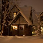 house-in-snow-at-night