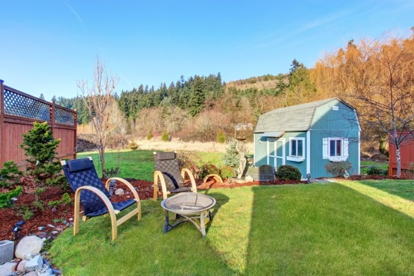 fenced-back-yard-with-blue-barn-shed
