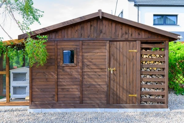 garden-shed-exterior-in-spring-with-woodshed