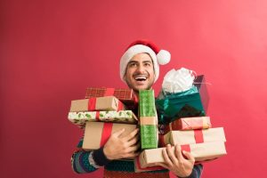 handsome man with presents during christmas