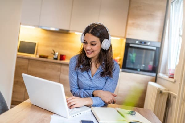 young beautiful businesswoman listening music in headphones