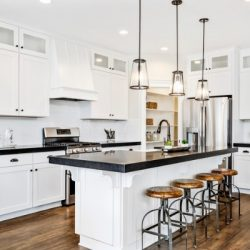 white gourmet kitchen with black countertops