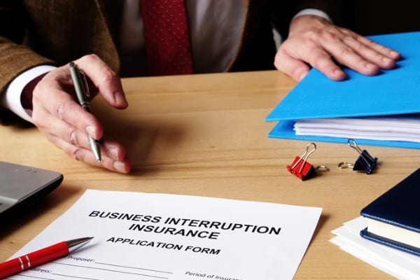 agent offers business interruption insurance application papers