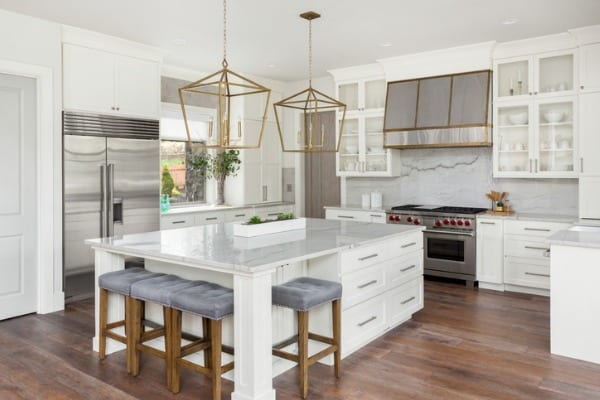beautiful kitchen in new luxury home with island pendant lights