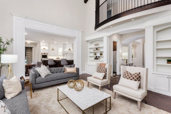 beautiful living room interior with tall vaulted ceiling loft area