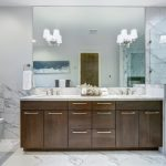 incredible master bathroom with carrara marble tile surround