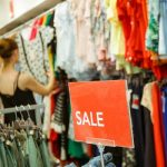 woman looking clothes on discount in the shopping mall seasonal sale