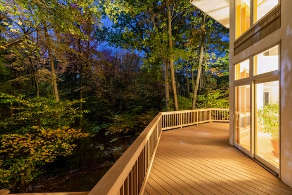 deck on home in woods at night