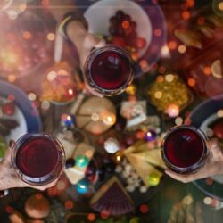 family christmas dinner for a celebration with red wine and cheers