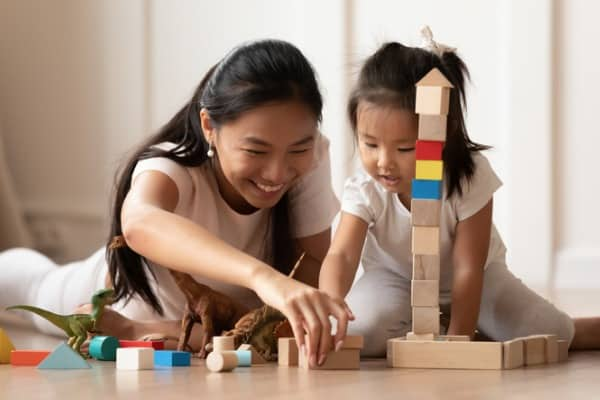 overjoyed vietnamese mother little daughter play at home