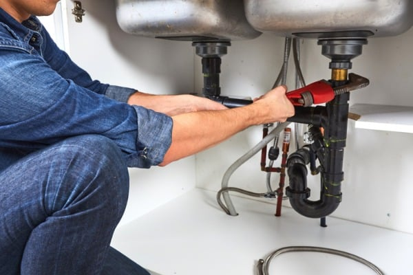 plumber with wrench